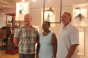 Asher Mains, with Minister of Culture Brenda Hood, and Curator Jose Noceda
